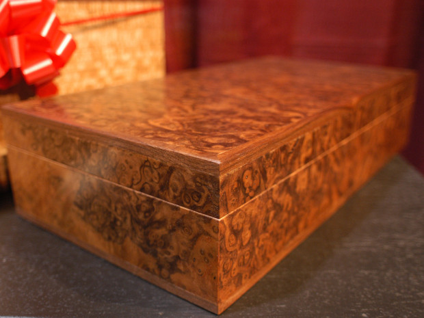 "Book matched Walnut Burl Box Walnut Burl veneer with inlaid Walnut. Solid brass stop hinges. 4.5""h × 18""w × 10""d"