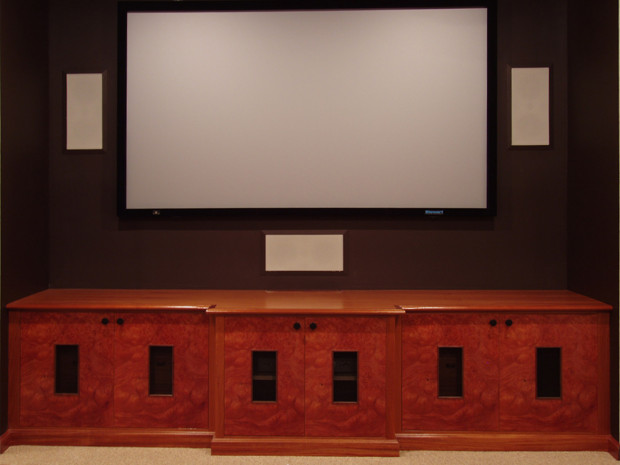 """Breakfront Credenza Home Theater Mahogany cabinets with Pelin Burl sequence matched panels,Mahogany drawers and shelves. Openings are made with Black Walnut inset moldings with black steel grills. Solid brass hardware with black enamel finish. 25""""h × 103""""w × 20"""" and 24""""d"""