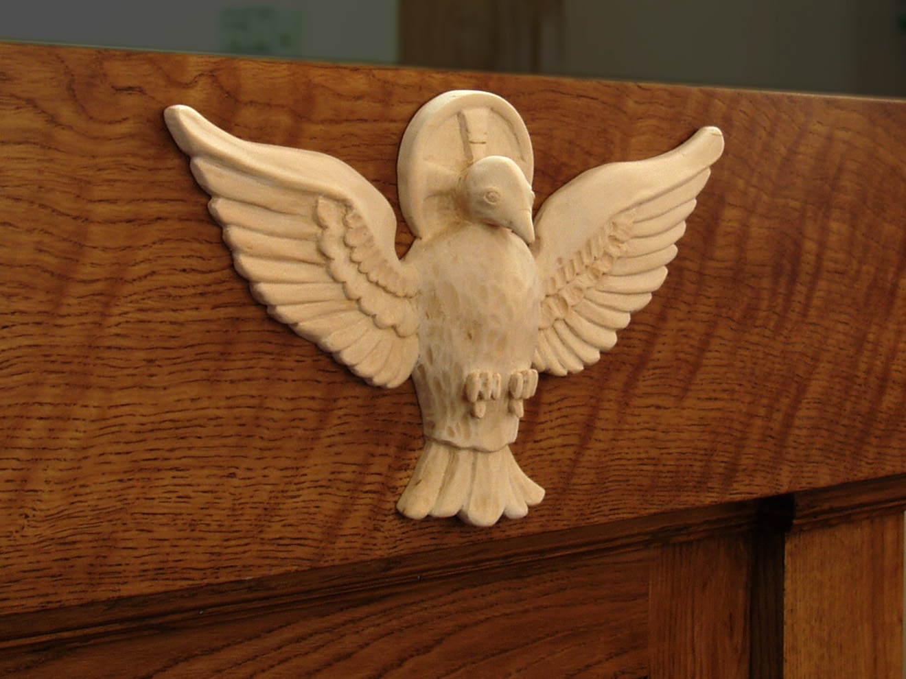 Carved Dove Hand-carved Linden Wood on White Oak lectern. Part of a larger project that includes a lectern, alters and a tabernacle.