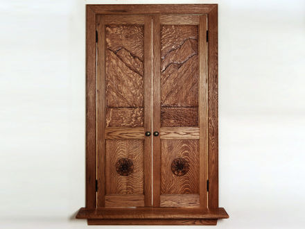 "Carved White Oak Doors Hand carved White Oak panels with Edelweiss rondels, medium Oak stain with varnish finish, custom moldings and sill, mortise & tenon. 54""h × 26""w"
