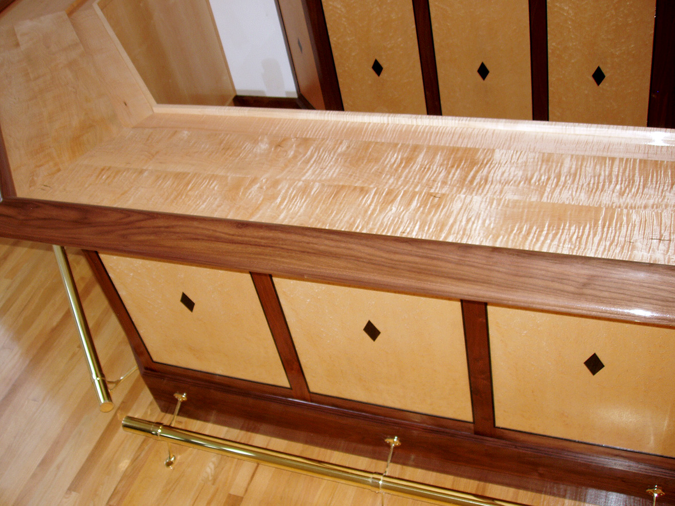 """Custom Deco Bar Solid Tiger Maple, Walnut handrail, sequence matched Birdseye Maple, Ebony inlays and moldings. Solid brass foot rails and brackets. Mortise and tenon and mitre/spline joinery. bar - 42""""h × 16'l × 24""""d (9'd overall) cabinet - 96""""h × 74""""w × 13""""d"""