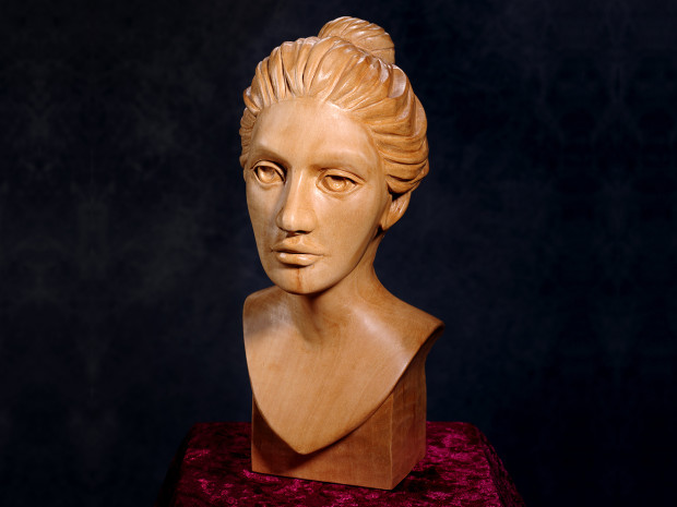"Debra Hand carved from Basswood. 10 ½""h × 4""w × 6""d"