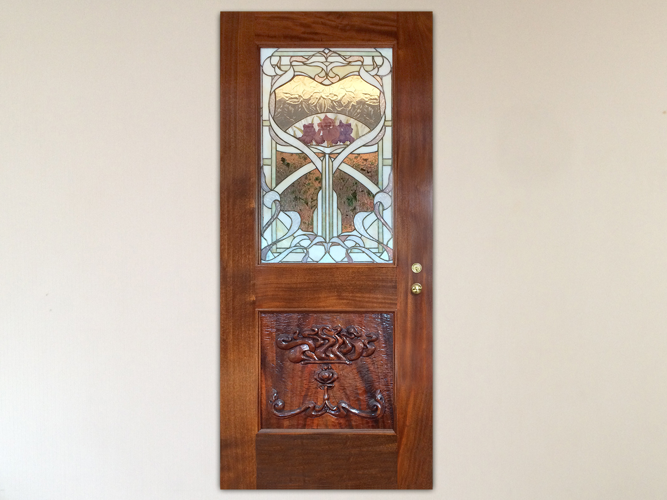 "Honduras Mahogany Door Solid Honduras Mahogany, hand-carved panel. Mortise and Tenon construction. Varnish finish. Custom stained glass with etched and hand painted Irises by Hector Studio of Frenchtown, NJ. 80""h × 36""w × 2""d"