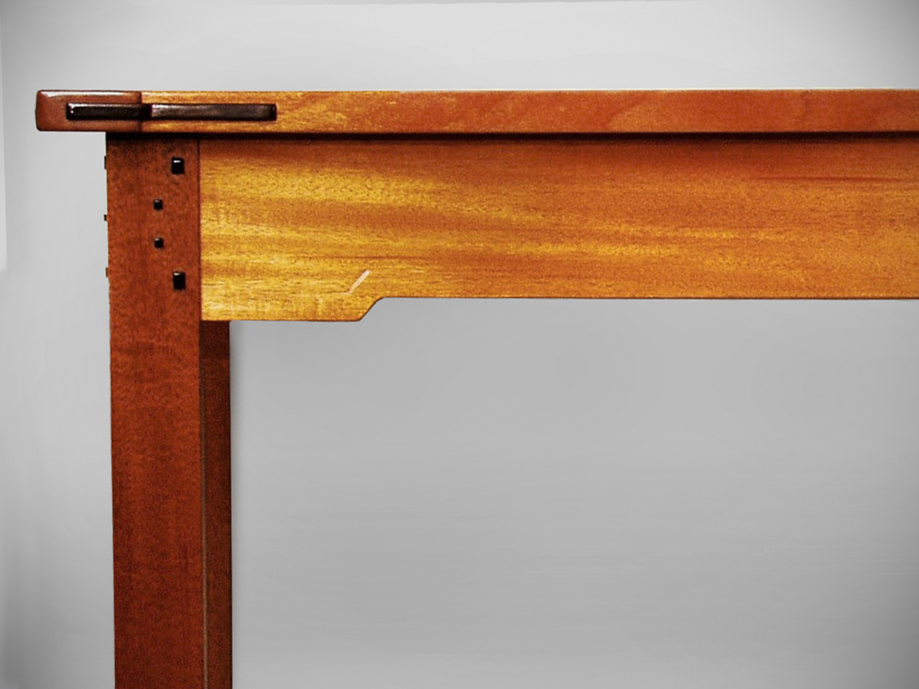 """Solid genuine Mahogany with Ebony pegs and keys. Hand-carved Arts and Crafts tree on long rails. Hand carved Zinnias on drawer fronts. Haunched mortise and tenon construction with hand rubbed varnish finish. 30""""h × 84""""l × 46""""w"""