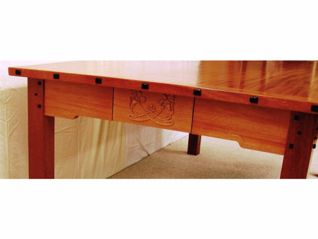 "Solid genuine Mahogany with Ebony pegs and keys. Hand-carved Arts and Crafts tree on long rails. Hand carved Zinnias on drawer fronts. Haunched mortise and tenon construction with hand rubbed varnish finish. 30""h × 84""l × 46""w"