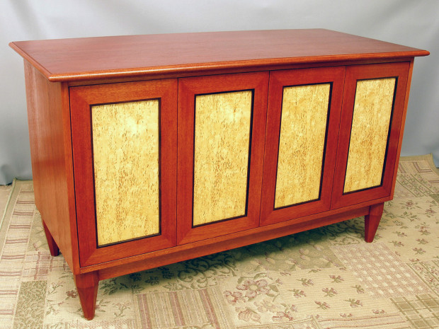 "Karelian Burl Credenza Solid Mahogany stained with hand tapered octagonal legs, Karelian Burl veneer panels with cocobolo inset moldings, touch latch doors, mortise & tenon joinery. 32""h × 55""w × 22""d"