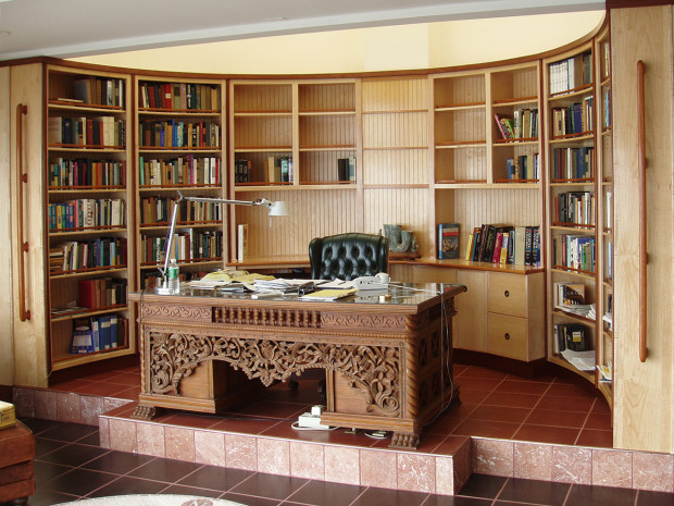 """Radiused Library and Home Office (nautical design) Maple cabinets with Sapele and Mahogany moldings. Hand-Sculpted Mahogany hand rails. Book matched Karelian Burl desktop with Mahogany moldings solid brass gallery posts with bent lamination Mahogany. Bent lamination Maple rails. Lacquer finish. Bookcase 96""""h × 32""""w × 12""""d Desk Area 32""""h × 108""""w × 22""""d"""
