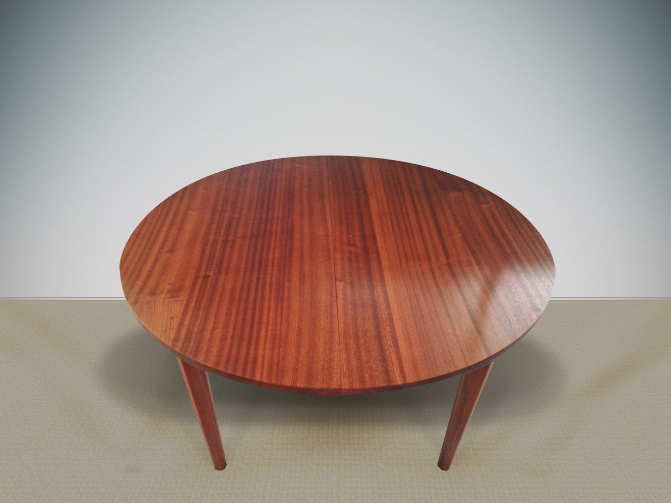 "Round Extension Dining Table Ribbon-stripe Sapele, Ebony pegs, mortise and tenon construction, hand-planed tapered legs 30""h × 48""dia., leaf is 24""w and includes apron"