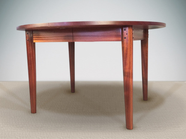 """Round Extension Dining Table Ribbon-stripe Sapele, Ebony pegs, mortise and tenon construction, hand-planed tapered legs 30""""h × 48""""dia., leaf is 24""""w and includes apron"""