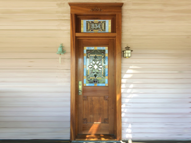"Solid Sapele Door Solid Sapele, varnish finish, hand carved Acanthus leaves carvings and scroll. Hector Studio Glass – Frenchtown, NJ. 106""h × 36""w × 1.75d"