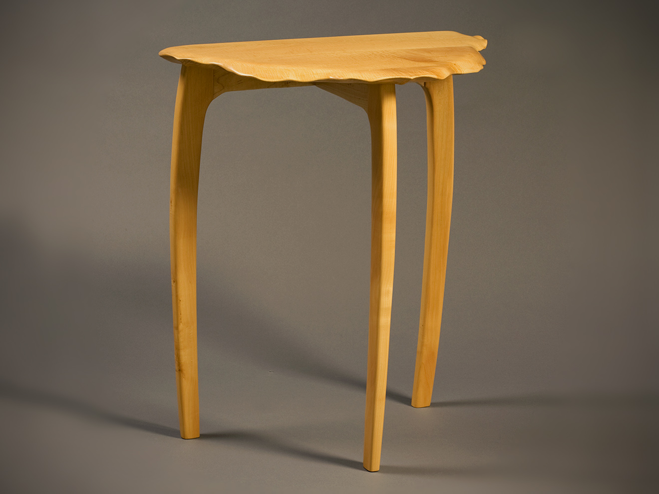 """Swiss Pear Table Hand sculpted Swiss Pear table top with curly Maple apron and sculpted Swiss Pear legs. Mortise and tenon construction. Various woods available. 32""""h × 27.5""""w × 16""""d"""