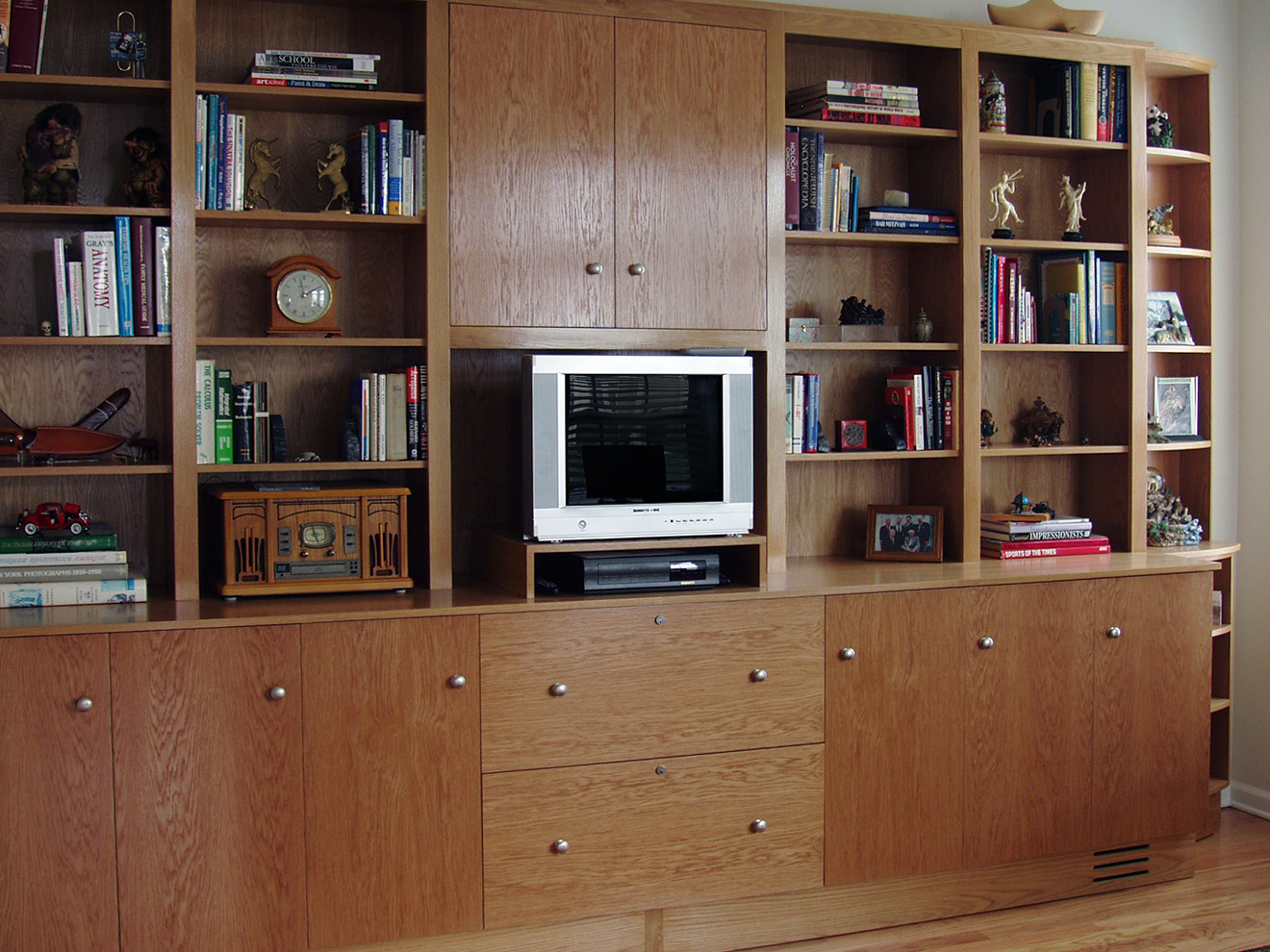 """White Oak Home Office White Oak cabinets with radiused end cabinets. Pendaflex lateral side drawers with locks. Lacquer finish nickel hardware. Base cabinets 36""""h × 16""""w × 24""""d Upper cabinets 48""""h × 16""""w × 12""""d"""