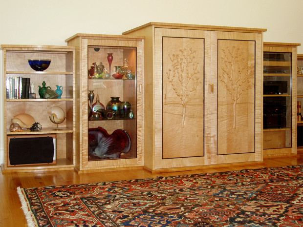 """Willow Home Entertainment Center Hand carved Swiss Pear door panel with Tiger Maple graduated cabinets & doors, sculpted Swiss Pear door pulls, Rosewood door moldings, cherry Base molding, mortise & tenon construction. 64""""h ×144""""w × 32""""d"""